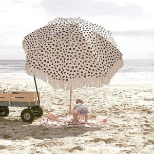 antique beach umbrella with tassels