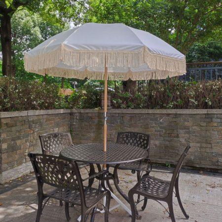 antique white beach umbrella with fringes