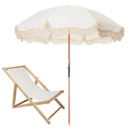 fringed beach umbrella with wood chair