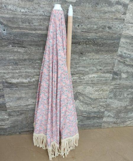 wooden pole beach umbrella