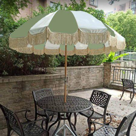 vintage patio table umbrella with wood pole and tassels